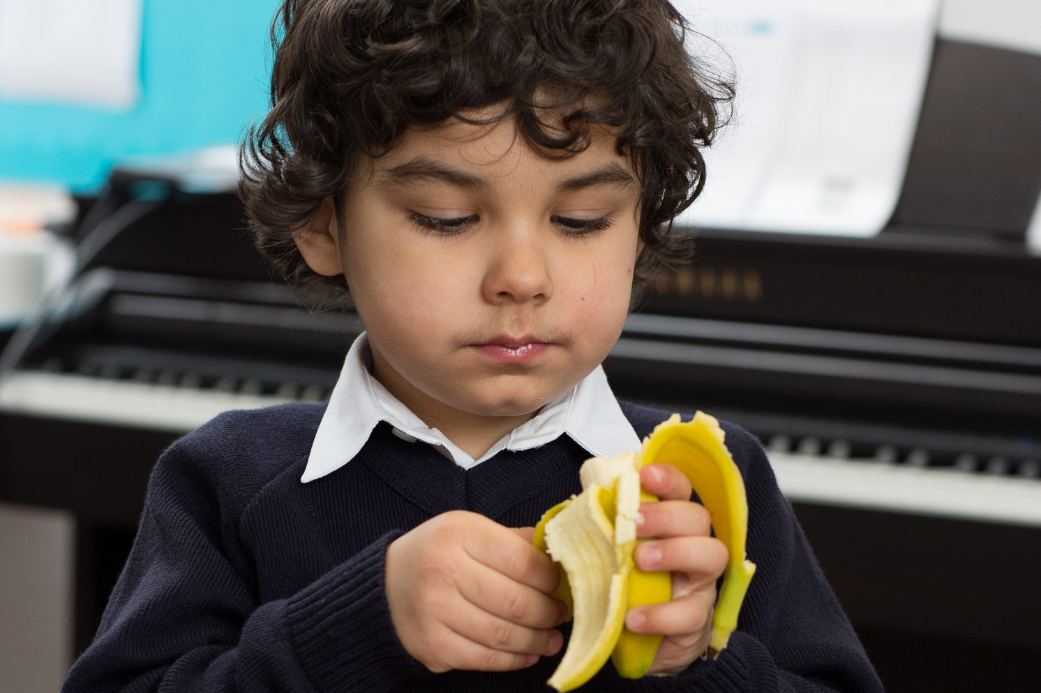 Boy peeling banana